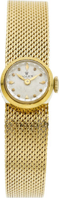 A ROLEX LADY'S GOLD WRIST WATCH  Property of a Dallas Lady
