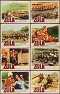 """Movie Posters:War, Zulu (Embassy, 1964). Lobby Card Set of 8 (11"""" X 14""""), Photos (8)(8"""" X 10""""), Uncut Pressbook (Multiple Pages, 13.5"""" X 20"""")....(Total: 17 Items)"""