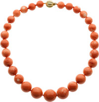 A CORAL, DIAMOND, GOLD NECKLACE