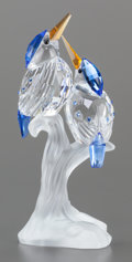 Art Glass, A SWAROVSKI CRYSTAL FIGURINE OF TWO PERCHED BIRDS. Circa 2000.Marks: (swan), ©. 4 inches high (10.2 cm). ...