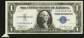 Error Notes:Attached Tabs, Fr. 1607 $1 1935 Silver Certificate. Extremely Fine.. ...