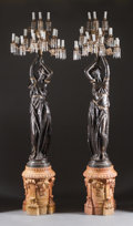 A PAIR OF LOUIS XVI-STYLE PATINATED BRONZE AND CUT GLASS FIGURAL EIGHTEEN-LIGHT TORCHÈRES ON MARBLE PEDESTALS Ear...