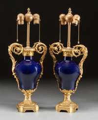 A PAIR OF SÈVRES-STYLE COBALT PORCELAIN AND GILT BRONZE VASES MOUNTED AS LAMPS 19th century 24-1/2 x 9 x 6 inch...