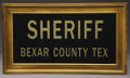 Western Expansion:Cowboy, BEXAR COUNTY SHERIFF SIGN - SAN ANTONIO, TEXAS CIRCA 1900-50 - Thissign is black glass, with reverse glass painted gold tha...