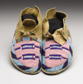American Indian Art:Beadwork, A PAIR OF CROW BEADED HIDE MOCCASINS. . c. 1890. ... (Total: 2Items)