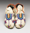 American Indian Art:Beadwork, A PAIR OF CROW BEADED HIDE MOCCASINS. . c. 1890. ... (Total: 2 Items)