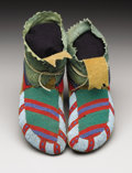 American Indian Art:Beadwork, A PAIR OF PLATEAU BEADED HIDE MOCCASINS. . c. 1900. ... (Total: 2Items)