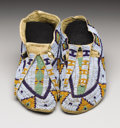 American Indian Art:Beadwork, A PAIR OF SIOUX BEADED HIDE MOCCASINS. c.1880. . ... (Total: 2Items)