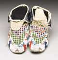 American Indian Art:Beadwork, A PAIR OF SIOUX PICTORIAL BEADED HIDE MOCCASINS. c. 1920. ... (Total: 2 Items)