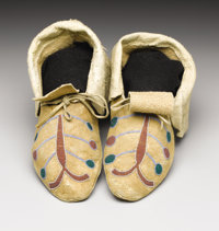 A PAIR OF PLATEAU BEADED HIDE MOCCASINS c. 1890