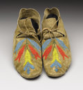 American Indian Art:Beadwork, A PAIR OF NORTHERN PLAINS BEADED HIDE MOCCASINS. . c. 1910. ...(Total: 2 Items)
