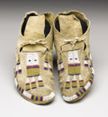American Indian Art:Beadwork, A PAIR OF ARAPAHO BEADED HIDE MOCCASINS. . c. 1890. ... (Total: 2Items)