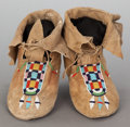 American Indian Art:Beadwork and Quillwork, A PAIR OF CROW BEADED HIDE MOCCASINS. c. 1900... (Total: 2 )