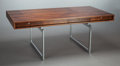 Furniture : Continental, BODIL KJAER (Danish, b. 1932). Desk (Model 901), 1959-60.Rosewood, veneer, chrome-plated steel, chrome-plated brass. 28...(Total: 2 Items)
