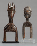 Paintings, Baule (Côte d'Ivoire, Western Africa). Heddle pulleys with human head and janus heads (pair). Wood. Height: 9 inches (larges... (Total: 2 Items)