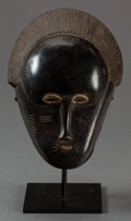 Tribal Art, Baule (Côte d'Ivoire, Western Africa). Portrait face mask. Wood,fiber and metal. Height: 15-1/2 inches. ...