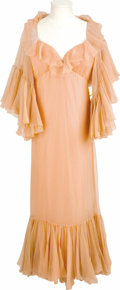 "Movie/TV Memorabilia:Costumes, ""Funny Lady"" Barbra Streisand Costume. A light salmon chiffon dresswith lots of ruffles, a matching salmon chiffon cape and... (Total:1 Item)"