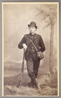 Photography:Cabinet Photos, CABINET CARD OF WEALTHY CHINESE IMMIGRANT WITH A WINCHESTER. Unnamed well-to-do Chinese man poses in his fancy hunting duds... (Total: 1 Item)