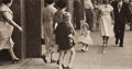 Photographs:20th Century, ESTHER BUBLEY (American, 1922-1998). Untitled (Strolling),circa 1950. Gelatin silver. 10-1/2 x 20 inches (26.7 x 50.8 c...