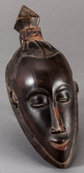 Tribal Art, Guro (Côte d'Ivoire, Western Africa). Face mask. Wood and pigment.Height: 14-3/4 inches. ...