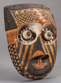 Tribal Art, Kuba (Democratic Republic of the Congo, Central Africa). Pwoomitok face mask. Wood, pigment and metal. Height: 10 inche...