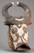 Tribal Art, Gurunsi (Burkina Faso, Western Africa). Cap mask depicting bushcow. Wood and pigment. Height: 16 inches. ...