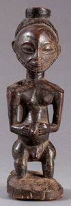 Tribal Art, Hemba (Democratic Republic of the Congo, Central Africa).Singiti male figure. Wood. Height: 11 inches. ...