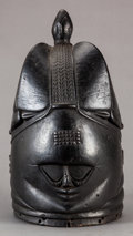 Tribal Art, Mende (Sierra Leone, Western Africa). Helmet mask for Sandeassociation. Wood, pigment and fiber. Height: 14-3/4 inches...