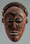 Tribal Art, Chokwe (Angola or Democratic Republic of the Congo, CentralAfrica). Mwana pwo face mask. Wood, pigment, fiber andglass...
