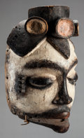 Tribal Art, Ibibio (Nigeria, Western Africa). Face mask . Wood, pigment andfiber. Height: 10-1/2 inches. ...