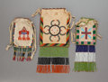 American Indian Art:Beadwork and Quillwork, THREE APACHE BEADED HIDE DRAWSTRING POUCHES. c. 1900... (Total: 3 )
