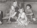 Photographs, RUSSELL LEE (American, 1903-1986). Mother with Children at Migrant Camp, Weslaco, Texas, 1939. Gelatin silver . 9-3/4 x ...