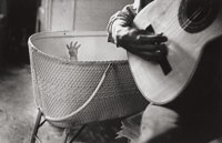 RALPH GIBSON (American, b. 1939) Baby's Hand with Guitar, 1960-61 Gelatin silver 4-3/4 x 7-3/8 in