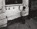 Photographs:Gelatin Silver, W. EUGENE SMITH (American, 1918-1978). Pittsburgh (Child PuttingHand Impressions on Wall), 1955-56. Gelatin silver. 8-3...