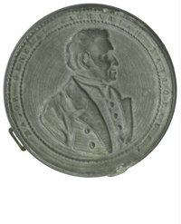 Zachary Taylor Shaving Mirror. 65mm pewter encased mirror with raised bust of Taylor looking to the right, inscribed &qu...