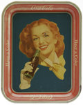 Advertising:Soda Items, 1950s Girl with Bottle Serving Tray in the Rare Version. The more unusual version of this tray is featured here; the solid b...