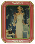 Advertising:Soda Items, 1936 Glamour Girl Coca-Cola Serving Tray. This tray features aflaxen hair beauty in a long white evening gown holding her f...