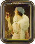 Advertising:Soda Items, 1921 Coca-Cola Advertising Tray pictures a flapper girl at a partygazing into her glass of Coke. Typical of the period, the...