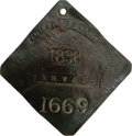 Antiques:Black Americana, 1838 Charleston SERVANT Slave Hire Badge. Number 1669. A slightlyconvex diamond-shaped tag with clipped corners, holed at t...