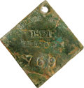 Antiques:Black Americana, 1851 Charleston SERVANT Slave Hire Badge. Number 769. A flat,nearly concave, diamond-shaped tag with a hole at the top for ...