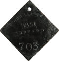 Antiques:Black Americana, 1851 Charleston SERVANT Slave Hire Badge. Number 703. A flatdiamond-shaped tag with a hole at the top for suspension, 53mm ...