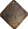 Antiques:Black Americana, 1842 Charleston SERVANT Slave Hire Badge. Number 962. A slightlyconvex diamond-shaped tag with clipped corners, holed for s...