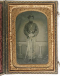 "Photography:Tintypes, Civil War Union Soldier Tintype in a Union Case under glass with abrass shell mat, 2.5"" x 3.75"". This gentleman with the in..."