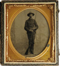 Photography:Tintypes, Cased 1/6th Plate Spanish-American Soldier tinype in excellentcondition, holding his rifle, with bayonet on his belt. Case ...
