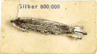 """Hindenburg Zeppelin Silver Pin from the 1936 Olympics. On the original card, marked """"Silver 800/1000"""". We have..."""