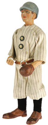 Vintage Baseball Figural Candy Container Clothed in a circa 1910-15 baseball uniform, sporting a glove, and holding a ba...