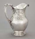 Silver Holloware, American, A GORHAM SILVER REPOUSSÉ RASPBERRY WATER PITCHER. GorhamManufacturing Co., Providence, Rhode Island, dated 1915. Marks:(li...
