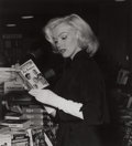 Photographs, ANDRE DE DIENES (American, 1913-1985). Marilyn Monroe at a Bookstore. Gelatin silver, 1992. 11-1/2 x 10-3/8 inches (29.2...