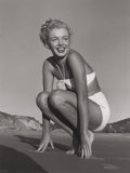 Photographs, ANDRE DE DIENES (American, 1913-1985). Marilyn Monroe (Tobey Beach White Swim Suit), 1949. Gelatin silver. 13 x 11 inche...