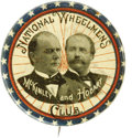 """Political:Pinback Buttons (1896-present), Ever-Popular 1896 McKinley & Hobart """"National """"Wheelman's Club"""" Jugate. Their portraits are superimposed over a bicycle whee..."""